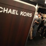 Models and staff prepare backstage before the Michael Kors Spring 2011 collection during New York Fashion Week