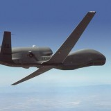 Northrop Grumman Media Resources Photo Gallery-RQ-4 Block 10 Global Hawk flying over mountains.