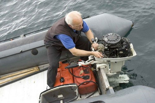 Engineer_person_working_on_boat_engine