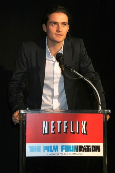 Netflix, Inc. (NASDAQ:NFLX), Sign, Logo, Brand, The Film Foundation, Orlando Bloom, red envelopes