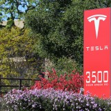 Tesla Motors Inc (NASDAQ:TSLA), Sign, logo, brand, stock, automaker, corporation