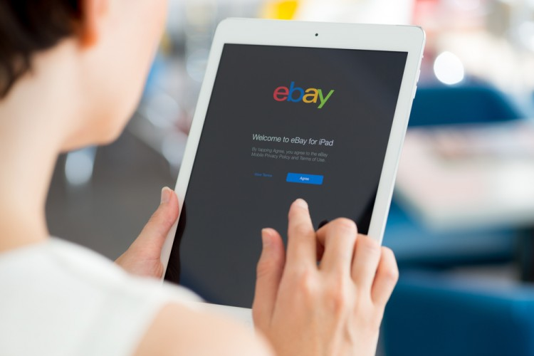 eBay Inc (NASDAQ:EBAY), eBay, homepage, welcome message, iPad, Apple, Sign, Symbol, Logo, Website