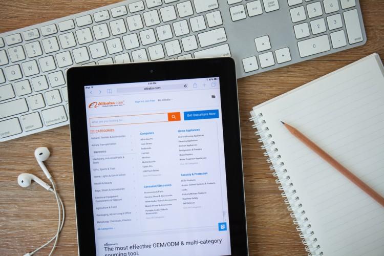 Alibaba Group Holding Ltd (NYSE:BABA), Alibaba homepage on a Ipad monitor screen, webiste, group, online