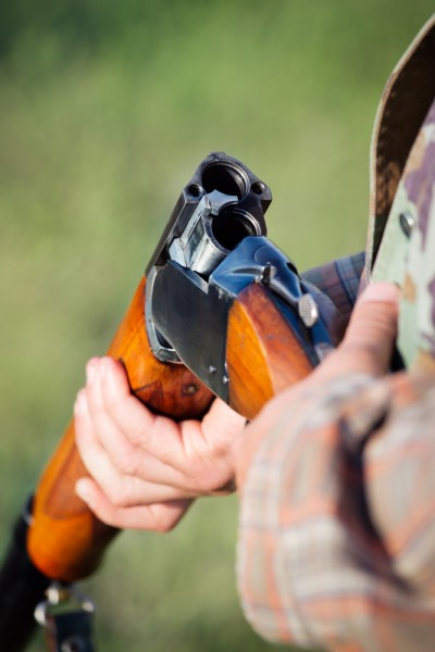 closeup, human, shotgun, activity, target, dart, male, rifle, camouflage, caucasian, equipment, season, recreation, trigger, bullet, gun, holding, safety, close, country, hobby, danger, wild, nature, man, hand, sport , gun, weapon,