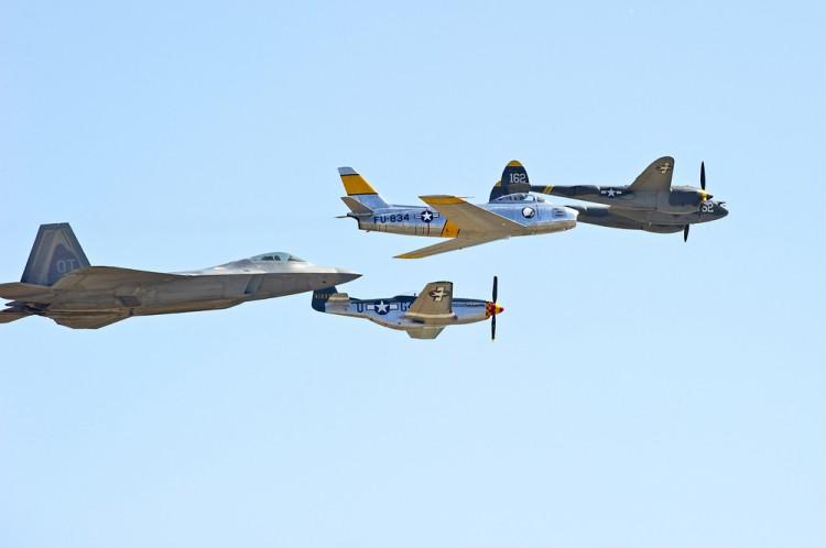 Lockheed Martin (NYSE:LMT); F-22 Raptor, jets, planes, fly, formation, aerodynamic, aeronautics, air, airborne, aircraft, military