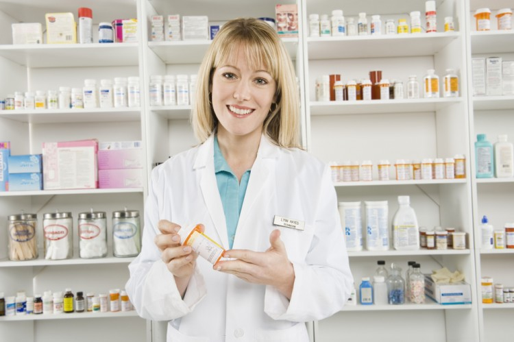 pharmacist, store, shelves, drugs, chemist, profession, horizontal, adult, drugstore, one, female, medicine, health care, woman, showing, prescribing, indoors, doctor, prescribe, sell, white, medical, retail, occupation, caucasian, smile, holding, standing, person, lab coat, shop, pharmacy,