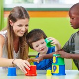kindergarten, teacher, child, tower, table, preschooler, preschool, toddler, boy, day, educator, worker, learn, nanny, woman, group, childhood, school, education, infant,