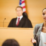 lawyer, court, courtroom, america, on, statement, view, legal, day, lawsuit, adult, talking, male, frowning, female, foreground, system, front, robes, of, woman, unsmiling,