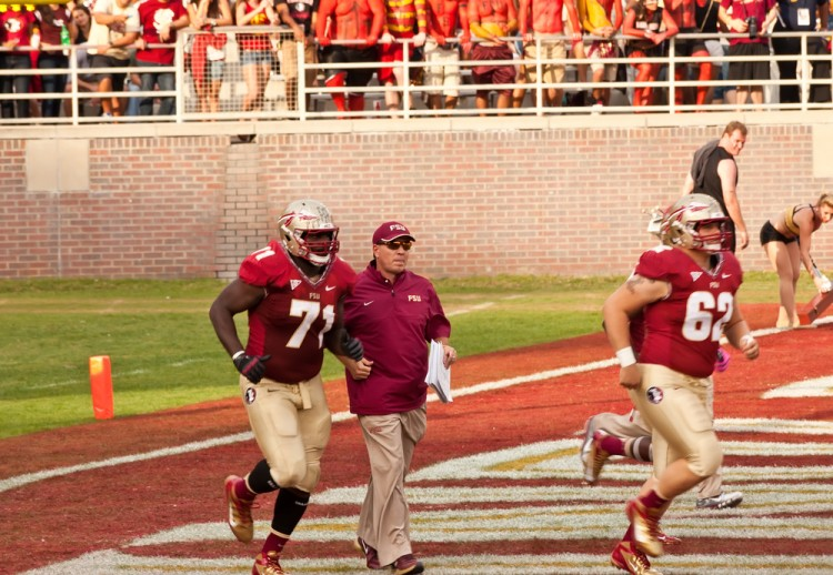 college students, helmets, tallahassee, fsu, cheering, football game, football players, field, football field, noles, head coach, defense, fans, people, doak campbell stadium, 11 Highest-paid College Football Coaches