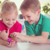 boy, girl, dices, room, table, experience, children, two, fun, preschool, poker, study, daycare, count, people, family, brother, face, childhood, school, home, education,