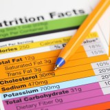 advice, ballpoint pen, cholesterol, close up, fact, fat, food, food and drink, healthy eating, healthy lifestyle, horizontal, information medium, information sign, information symbol, ingredient, label, nobody, nutrition, nutrition facts, nutrition label, paper, pen, percentage sign, reading, scale, studio shot, unhealthy eating