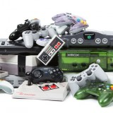 collection, console, consoles, controller, editorial, electronics, gamepad, games, gaming, heap, horizontal, isolated, joystick, microsoft, nes, nintendo, nobody, pile, playstation, retro, sega, sony, studio shot, system, systems, toys, video game, video games, white, white background, xbox